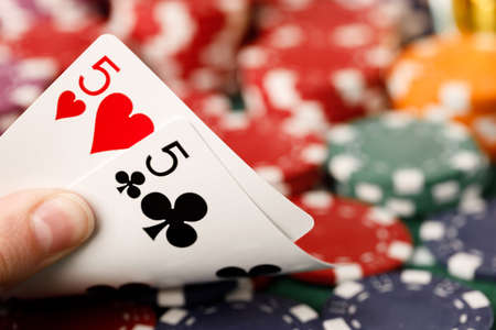 Female hand holding playing cards in casino