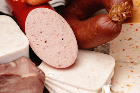 Variety of meat and sausage products on table Standard-Bild