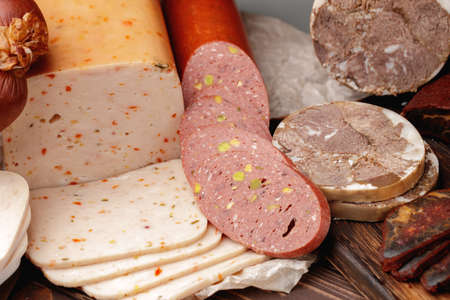 Variety of meat and sausage products on table