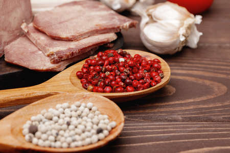 Assortment of meat and sausage on wooden surface Standard-Bild