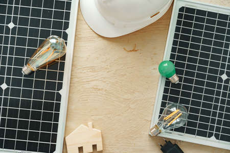 Wooden house miniature and solar panel close up Stock fotó