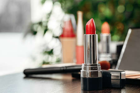 New red lipstick on vanity table close up