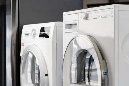 New washing machine in a home appliances store Standard-Bild