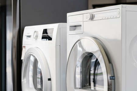 New washing machine in a home appliances store Imagens