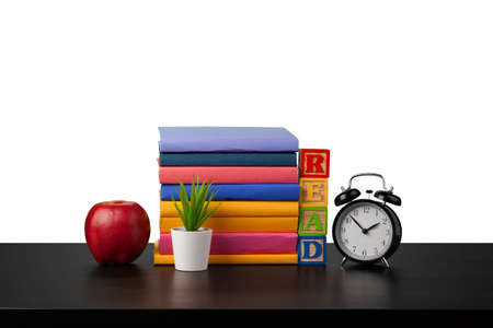 Stack of books and alarm clock, time to read concept Stock Photo