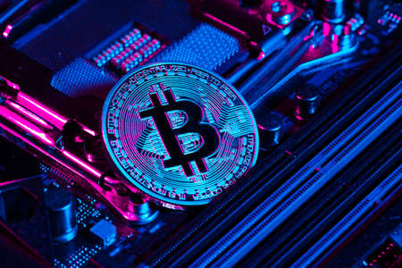 golden bitcoin and computer chip in background