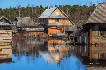 Flooded homes. Spring flood. Maksatikha 2013. Volchina river overflowed. Spring flood. Tver region.