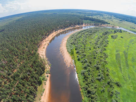 The view from the height of the river Mologa and forest along the sandy shore Stock Photo