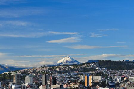 A clear morning in Quito, allows to observe the Cotopaxi Volcano Stock Photo