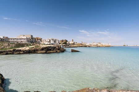 Panorama of Monopoli in Metropolitan City of Bari and region of Apulia (Puglia). On the background the cathedral of the Madonna della Madia