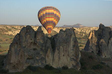 Balloon over rocks