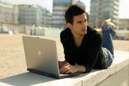 Attractive man with computer working outdoor Stock Photo - 942465