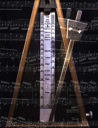Old metronome with blur motion on the black photo