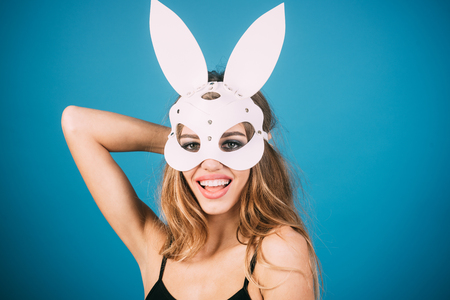 Masquerade party, carnival, New Year, halloween concept - pretty, happy, blonde, sexy woman in rabbit ears on head. Nice makeup.