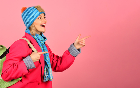 Happy woman in autumn clothes. Isolated on pink background. Autumn fashion. Copy space for advertising. Season sales. Winter, autumn sale.