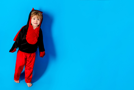 Boy play in costume dracula. Advertisement Halloween. Halloween decoration. 31 october. Happy Halloween quotes and sayings. Halloween party and funny Pumpkin. Funny boy in costume devils. Copy space.