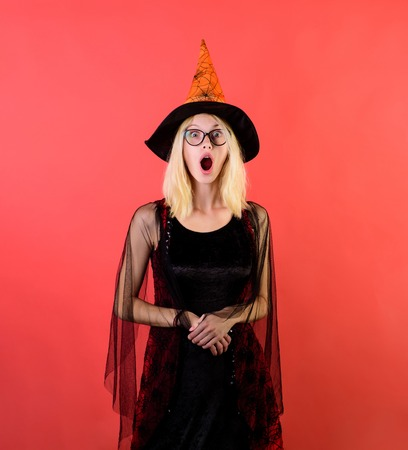 Happy Halloween. Secrets of magic. Witch in glasses. Wizard. Witch. Sorcerer. Magic hat & suit. Magic, enchantment, witchcraft. Halloween, holidays celebration. Girl on Halloween party. Trick or treat Imagens - 109737359