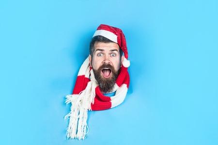 Surprised Man in Santa hat. Stock Photo