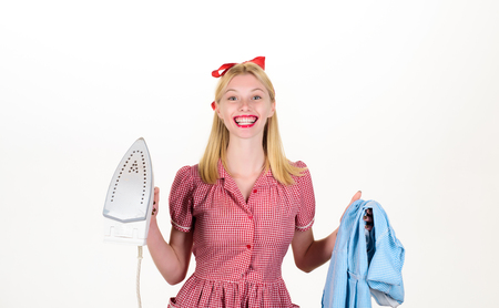 Pretty woman hold iron and dress to ironing. Household duties, taking care of house concept. Retro woman with laundry for ironing. Order services, wife, everyday life, housework. Pinup woman hold iron