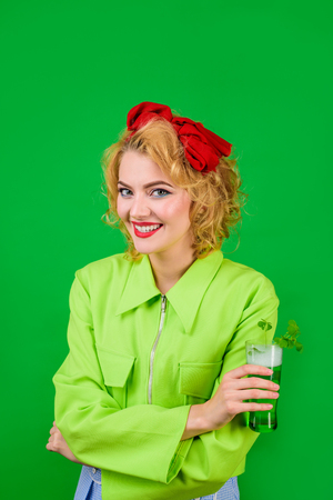 Patrick. Saint Patrick's Day. Woman holds glass with beer. St Patricks Day. Leprechaun. Green beer. Irish Traditions. Pub. Woman drinking in pub. Shamrock. Pin up girl. Standard-Bild