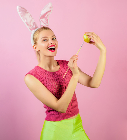 Happy moments and Easter celebration concept. Rabbit woman with bunny ears painting Easter egg. Sensual girl with rabbit ears painting Easter eggs. Cute lovely woman wearing bunny ears on Easter day. Banco de Imagens - 120031568