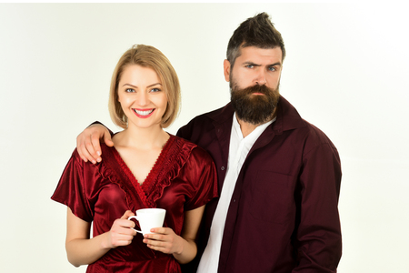 Amorous happy couple. Handsome bearded man embracing girlfriend. Cute couple has breakfast at home. Loving couple having breakfast. Copy space. Isolated on white background