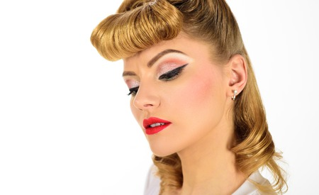 Eye makeup. Beautiful eyes retro style make-up. Holiday makeup. Eyeliner. Stylish retro lady. Pin up woman vintage. Sensual blonde girl with elegant makeup. Hairdo in retro style. Beautiful model girl