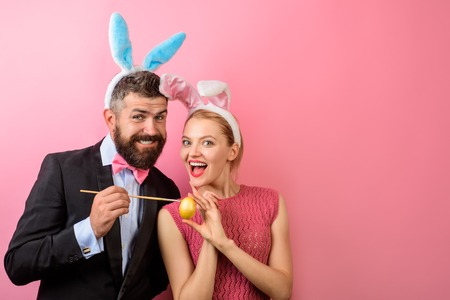 Easter Day. Family celebrate Easter. Happy couple painting eggs. Happy holidays. Couple painting eggs for Easter. Decorating eggs ideas. Holidays. Spring holidays. Bunny ears. Love. Stock Photo