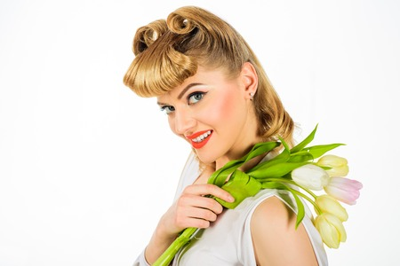 Happy birthday. Smiling woman with retro hairdo with tulips. Vintage style. Pin-up girl. Spring woman hold flower bouquet. Beauty, fashion concept. Beautiful girl in retro style with bouquet of tulips