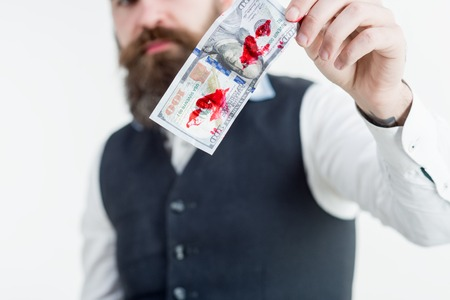 Business man, millionaire, billionaire. Finance. Bearded man holds banknote in blood. Business concept. Killed by money. Stock fotó