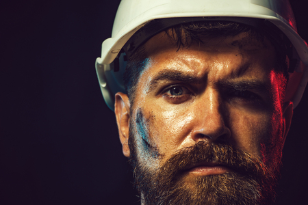 Construction worker in hard hat. Portrait of mechanical worker. Close up engineers working. Builder in protective clothing and helmet. Male builder. Portrait architect builder on construction site. Standard-Bild
