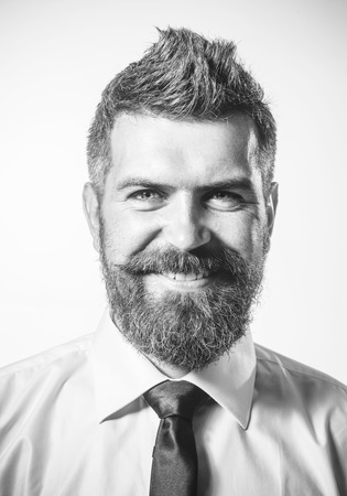Handsome smiling bearded businessman in formal clothing. Sexy stylish man with cool hairstyle. Mans style. Business, fashion and clothing concept - elegant handsome man in shirt and tie. Black&white. Stockfoto