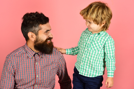 Family&childhood concept - happy father and son in checkered clothing looking at each other. Fathers day celebration - smiling boy and bearded father. Parenthood concept - happy daddy with cute son. 스톡 콘텐츠