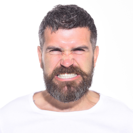 Angry man. Anger. Aggressive bearded man with stylish hair. Hipster with long beard and mustache with very angry and furious expression. Feeling and emotions. Man mad angry emotional portrait. Closeup Reklamní fotografie