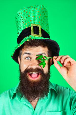 Saint Patricks Day. Happy four leafed clover. Green hat with clover. Saint Patricks Day symbols. Bearded man in green men hats celebrate Patricks Day. Patricks Day green shamrock. Ireland tradition.