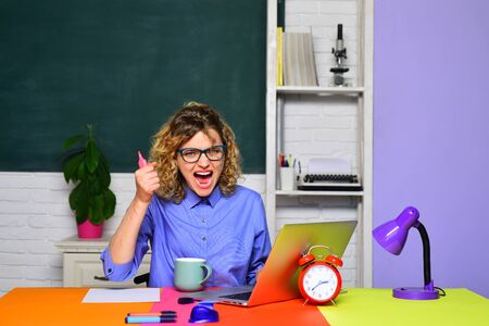 Back to school. Angry teacher working with laptop. Learning and education concept. Student and tutoring education concept. Smiling teacher in glasses. Homework. E-learning. Stock fotó