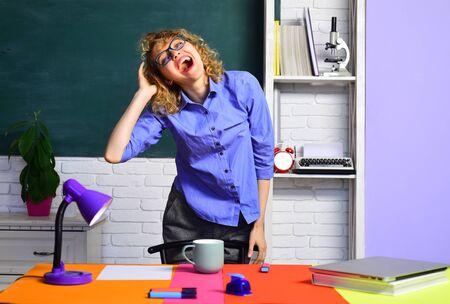 Smiling teacher. Back to school. Happy teacher. Hard schoolwork. Homework. Exam in college. Hard exam. School problems