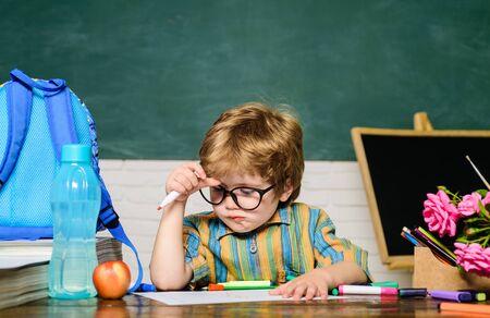 Back to school. Brainstorm. Schoolboy. Homework. Pupil in classroom. Lessons. School subjects. Science. Education concept. Nerd. Elementary school.