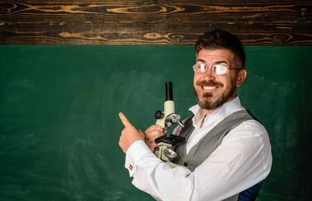 Teacher job. Learning concept. Professor at school lesson in classroom. Teacher preparing for university exams. Bearded teacher near chalkboard in school classroom. Preparing for exam in college. 免版税图像