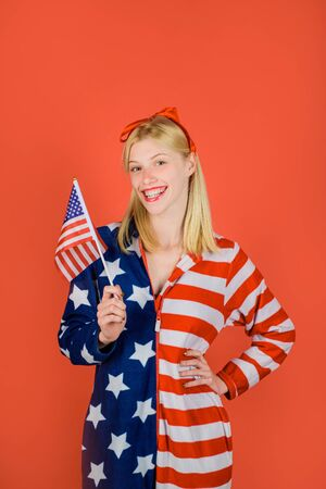 Make america great again. American flag. America. United states. USA. United states of America. US. Smiling woman with little american flag. Independence Day.
