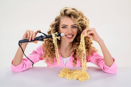Curlyhair girl eating noodles. Fast food noodles. Hairdresser. Hairdresser tools. Scissors. Hairdresser equipment. Makeup and cosmetics. Haircare.