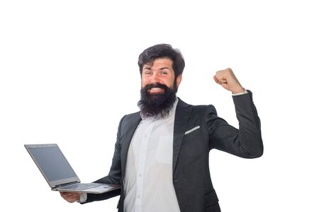 Handsome businessman holds laptop. Confident business expert. Businessman working with pc at office. Smiling bearded man with laptop. Happy businessman with computer. Bearded businessman holds laptop Stock Photo