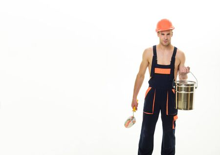 Painter man at work with roller, bucket. Painter concept. House renovation. Construction worker with painter roller bucket. Standard-Bild