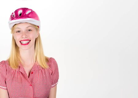 Beautiful woman in bicycle helmet. Sportswoman in protective helmet. Healthy and active concept. Sport athlete girl in stylish pink skating helmet. Copy space for advertise sport attributes store/shop Banque d'images