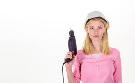 Worker woman with drill. Hard work of woman builder with drill. Seductive female builder in hard hat hold construction drill. Girl working at flat remodeling. Beautiful girl holds electric screwdriver