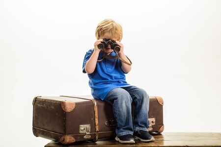 Boy tourist with big suitcase. Summer vacation, travel and adventure concept. Ready for new journey.