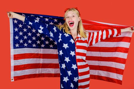 Happy woman covering by American flag.