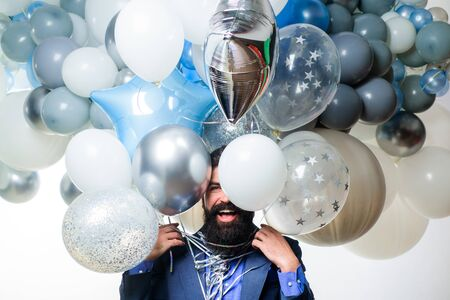Celebration, party, birthday, anniversary, festive occasions, surprise concept. Happy birthday. Balloon party. Happy bearded man with balloons. Happy man celebrating. Smiling man with helium balloons.