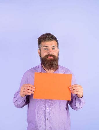 Bearded man holding advertising board. Advertising and sale. Online shopping. Advertising banner. Seasons sale. Discount. Marketing. Add. Copy space for text.