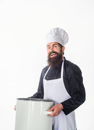 Male chef cook or baker in white apron&chef hat holds big crockery pot. Chef man cooking. Healthy food. Modern cook in professional uniform with pot. Smiling male chef with pot. Dishes, recipes menu.